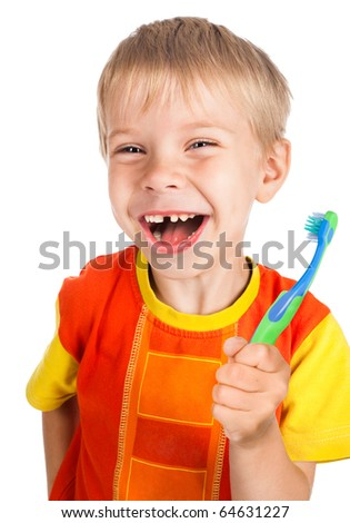 left-handed smiley boy with toothbrush without one tooth isolated on white background - stock photo