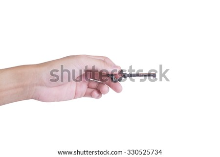 Left male hand with master key on white background