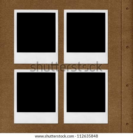 Left page of photo album with polaroid photo frames - stock photo