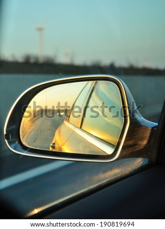 Left side's rear vision mirror of the car - stock photo
