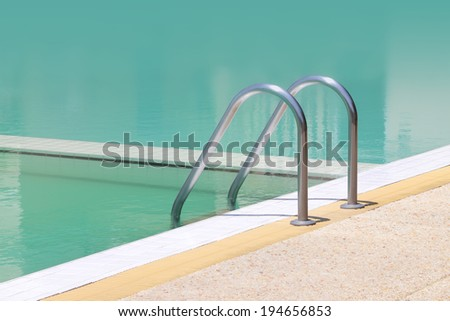 Left side stair bar arm of swimming pool.