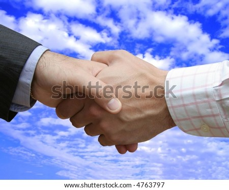 Lefthanded handshake in the blue sky