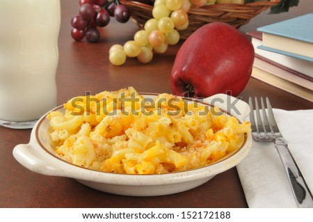 Leftover baked macaroni and cheese with milk as an after school snack