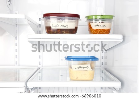 Leftover containers of food in a refrigerator for use with many food inferences. - stock photo