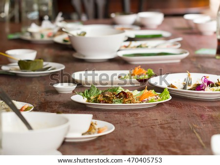 Leftover food on plate after dining table finish