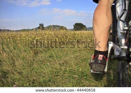 leg from a Mountainbiker - stock photo