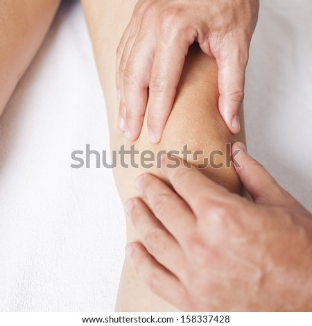 Leg massage - stock photo