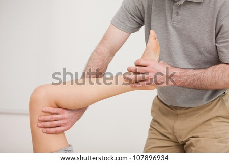 Leg of a patient being stretched in a room