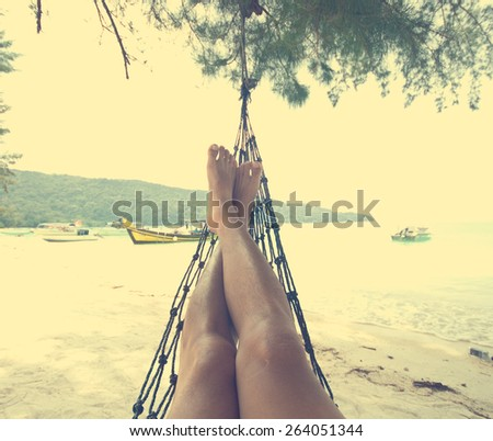 leg relaxing on beach, vintage tone - stock photo