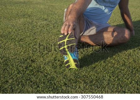 leg stretches Athletics, shoes - stock photo
