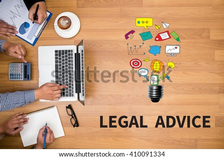 LEGAL ADVICE (Legal Advice Compliance Consulation Expertise Help) Business team hands at work with financial reports and a laptop - stock photo