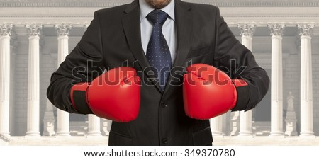 Legal concept. The lawyer in red boxing gloves - stock photo