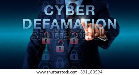Legal consultant is touching CYBER DEFAMATION on a virtual interface. Information technology concept for defamation via malicious online commentary in forums, websites and internet portals. - stock photo