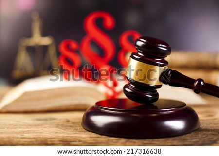 Legal gavel on a law book  - stock photo