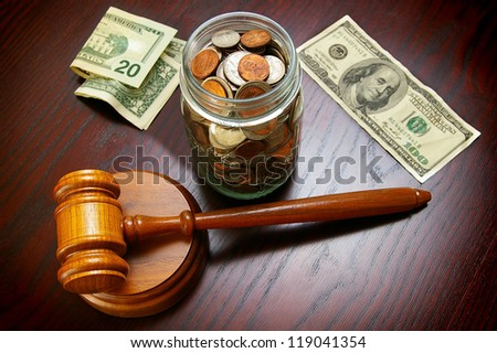 legal gavel with cash and coins - legal or divorce concept - stock photo