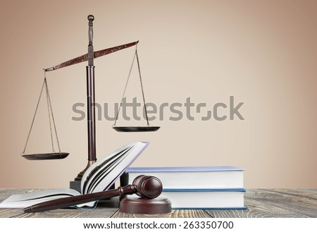 Legal. Golden scales of justice, gavel and books isolated on white - stock photo