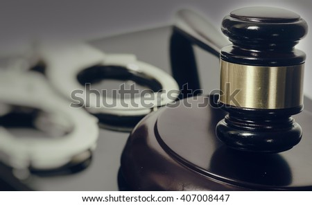 Legal law concept image - gavel and handcuffs