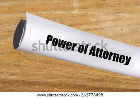 legal power of attorney document on wood background - stock photo