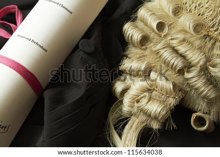 Legal Still Life Of Barrister's Wig, Gown And Brief - stock photo