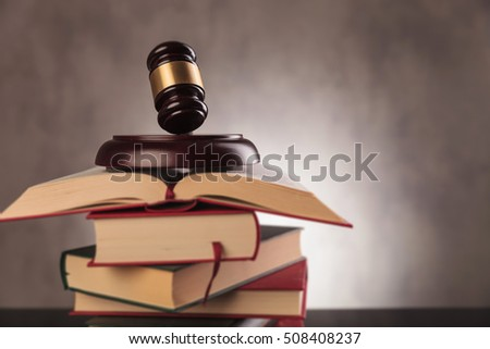 legal system concept. judge's gavel on top of a pile of books