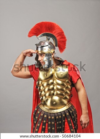 Legionary soldier looking for an enemy - stock photo