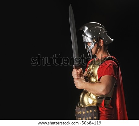 Legionary soldier with gladius - stock photo