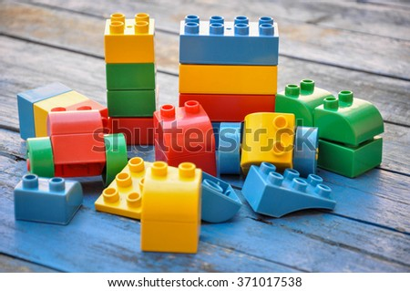 lego plastic toy blocks on blue wood table