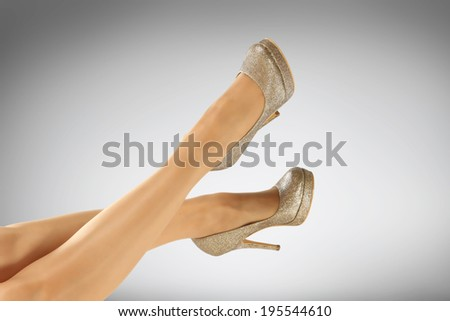 legs and gray space  - stock photo