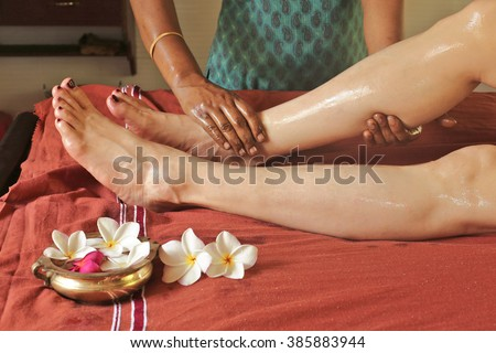 Legs and hands with oil Ayurveda massage  - stock photo