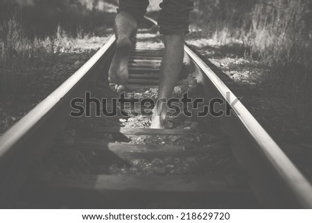 legs and railway  - stock photo