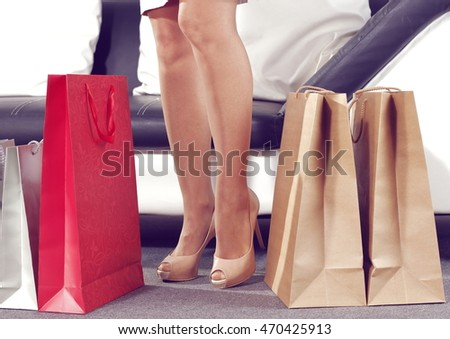legs and red bags with brown bags