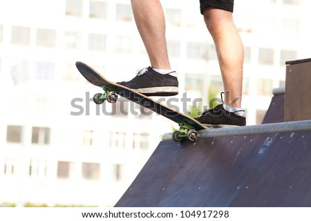 legs and the board skateboarder at the start. Close-up. unrecognizable - stock photo