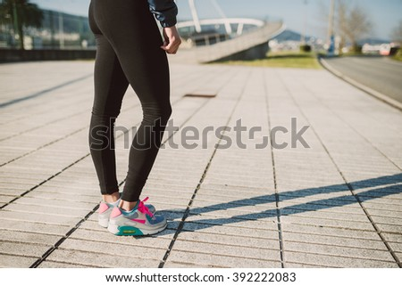 Legs detail of a female runner outdoors