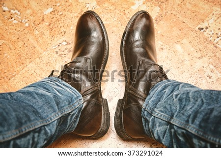 legs in jeans and leather boots - stock photo