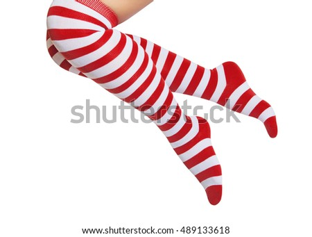 Legs in red and white striped socks isolated on white background