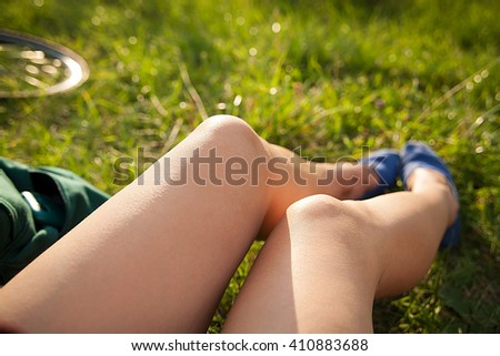 legs in sport shoes on grass