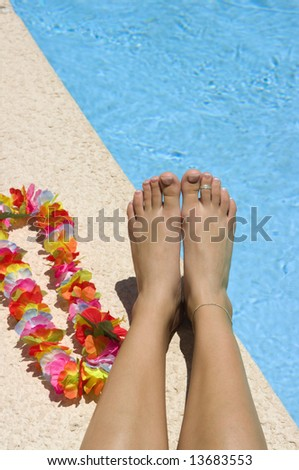 Legs near pool - stock photo