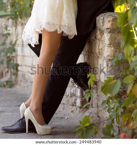 Legs newlyweds in wedding day - stock photo