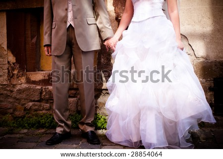 Legs of a bride and groom - stock photo