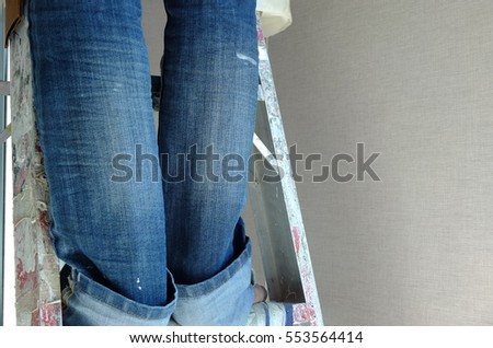 Legs of a construction worker