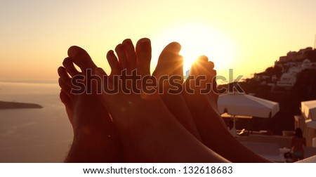 Legs of a couple at sunset