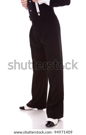 legs of a latino male dancer or a man wearing gangster black and white shoes, on white background - stock photo