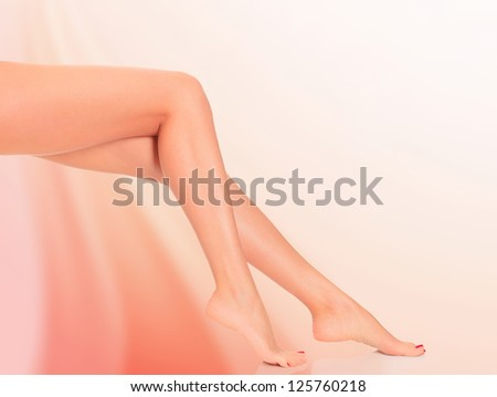 Legs of a woman against abstract background - stock photo