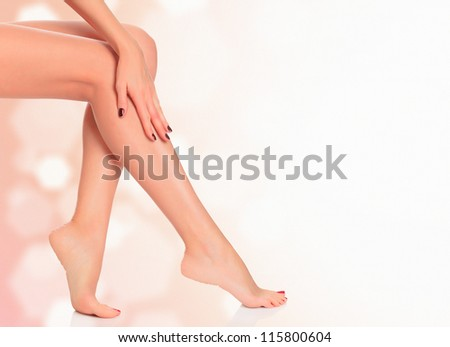 Legs of a woman against abstract background with copyspace - stock photo