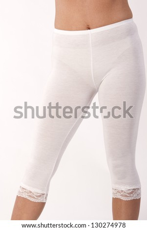Legs of a woman with white leggings with lace /  white leggings - stock photo