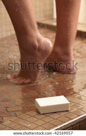 Legs of a young caucasian adult woman in shower