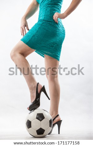 Legs of an attractive soccer mom - stock photo