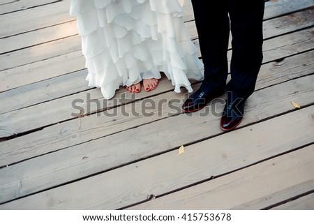 legs of bride and groom - stock photo