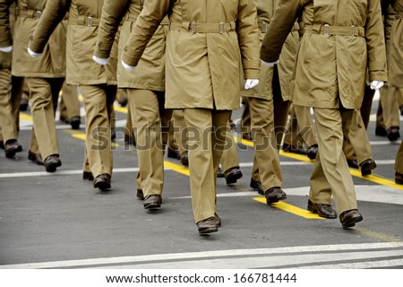 Legs of military personnel are seen during a national day parade - stock photo