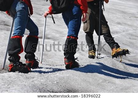 legs of mountain climbers - stock photo